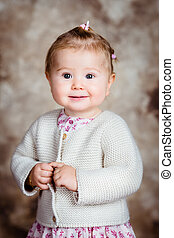 Portrait of sweet blond little girl with big grey eyes