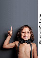 sweet little boy pointing upwards