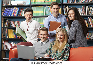 Portrait Of Teacher With Students In Library