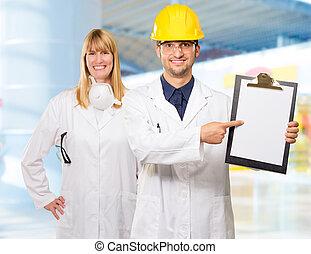 Portrait Of Technician Showing On Clipboard