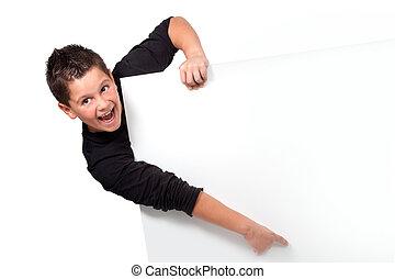Portrait of teen boy pointing finger on copyspace