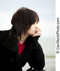 Portrait of teen girl at outdoor.