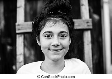 Portrait of teen girl outdoor. Black and white photography.
