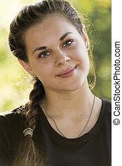 Portrait of teen girl outdoors