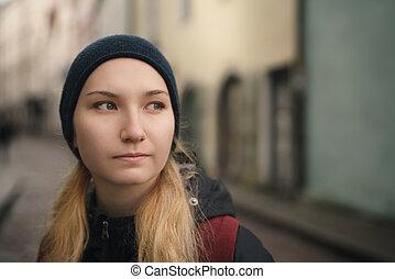 portrait of teen girl walking in the city in autumn