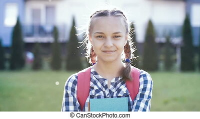 Portrait of teen girl with backpack - Close up emotional...