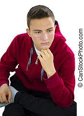 Portrait of teenage boy looking down