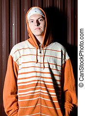 Portrait of teenage criminal - Young street gang member on...