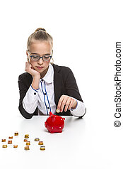 Portrait of Teenage Girl in Dark Jacket Putting Coin Into The Piggybank For Savings. Vertical Image Composition