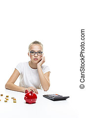 Portrait of Teenage Girl Posing With Coins and Moneybox. Calculating Income With Calculator. Vertical Image Orientation