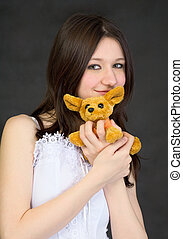 Portrait of teenage girl with favorite toy
