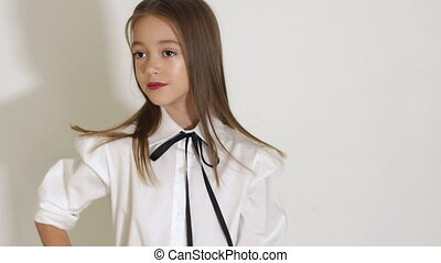 Portrait of teenage girl with long hair in Studio on white background.