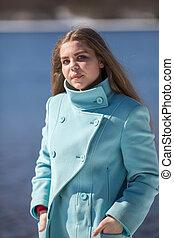 Portrait of teenager girl outdoors.