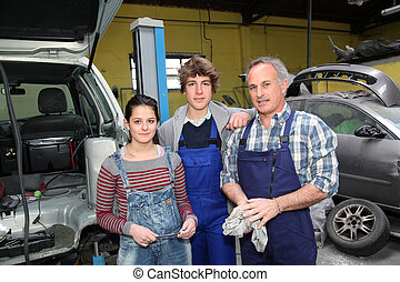 Portrait of teenagers in mechanics training course