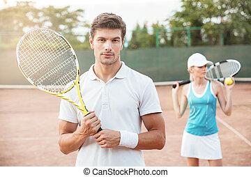 Portrait of tennis couple