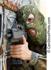 Portrait of terrorist with a gun