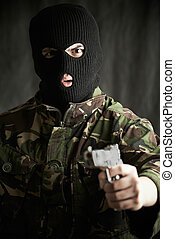 Portrait Of Terrorist With Gun Addressing Camera