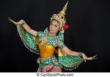 Portrait of Thai young lady in an ancient Thailand dance wea...
