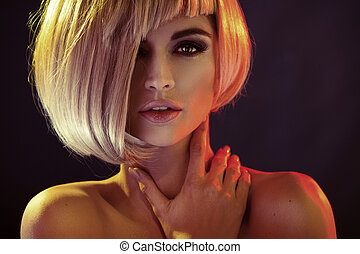 Portrait of the alluring woman with trendy coiffure