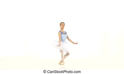 Portrait of the ballerina in ballet pose on white