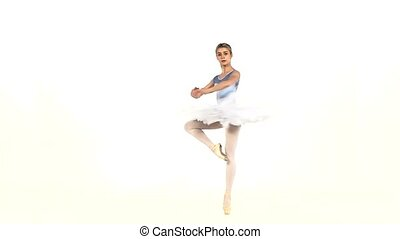 Portrait of the ballerina in ballet pose on white, slow motion