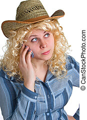 beautiful blonde girl in straw hat with cellular phone