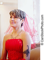 Portrait of the beautiful bride in a red dress