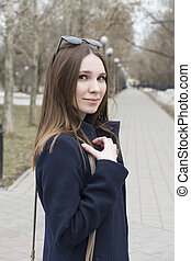 Portrait of the beautiful Russian girl in the park.