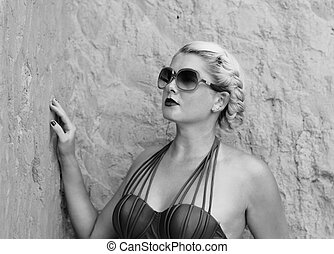 portrait of the beautiful woman at the rock, the black-and-white photo