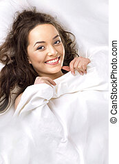 Portrait of the beautiful  woman sleeping in white bed