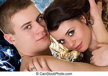 Portrait of the beautiful young couple. Isolated