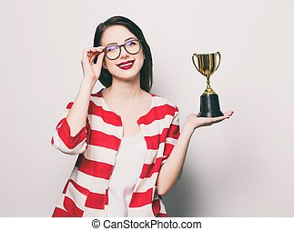 young smiling woman with cup trophy