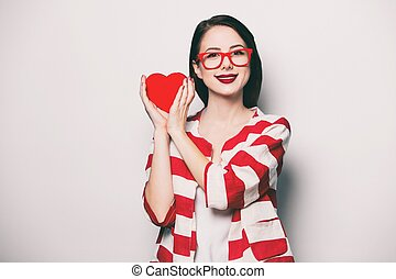 smiling woman with heart shape box
