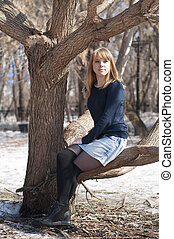 Portrait of the beautiful young woman in the park.