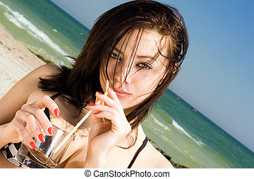 Portrait of the beautiful young woman on a beach