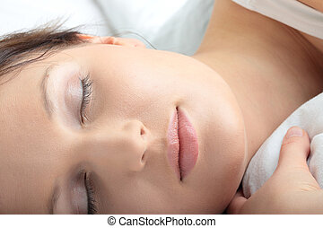 Portrait of the beautiful young woman sleeping