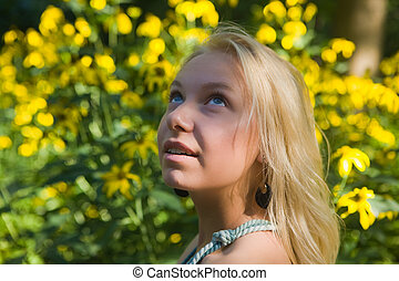 blonde against yellow flowers