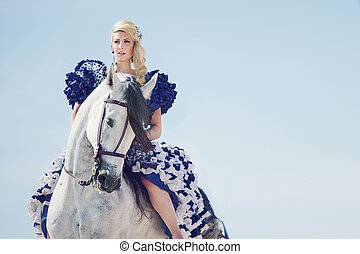 Portrait of the blonde riding a horse