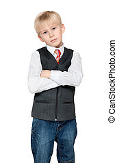 Portrait of the boy in vest and tie