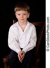 Portrait of the boy on a black background