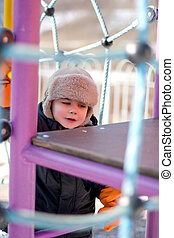 Portrait of the boy on a children's playground