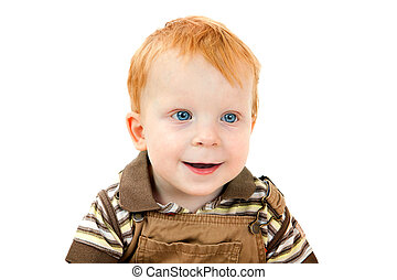 Portrait of the boy with red hair and blue eyes