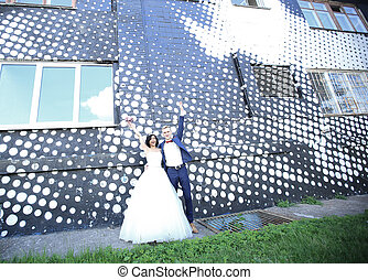 bride and groom on a background of city buildings