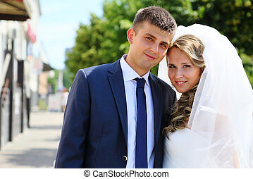 Portrait of the bride and groom on a city street