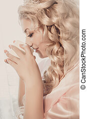 portrait of the bride with a cup of coffee