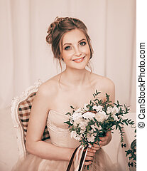 portrait of the bride with a wedding bouquet.