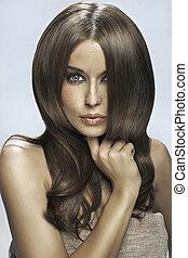 Portrait of the brunette woman