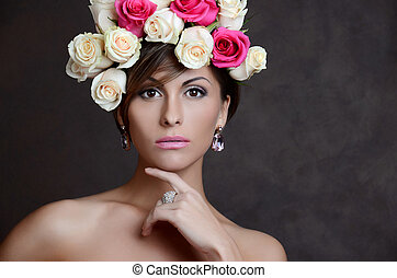 portrait of the  brunette woman with pink flowers in hair