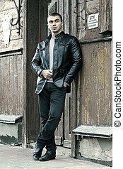 brutal young man in a leather jacket - portrait of the ...