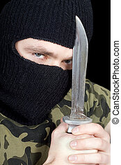 Portrait of the criminal with a knife
